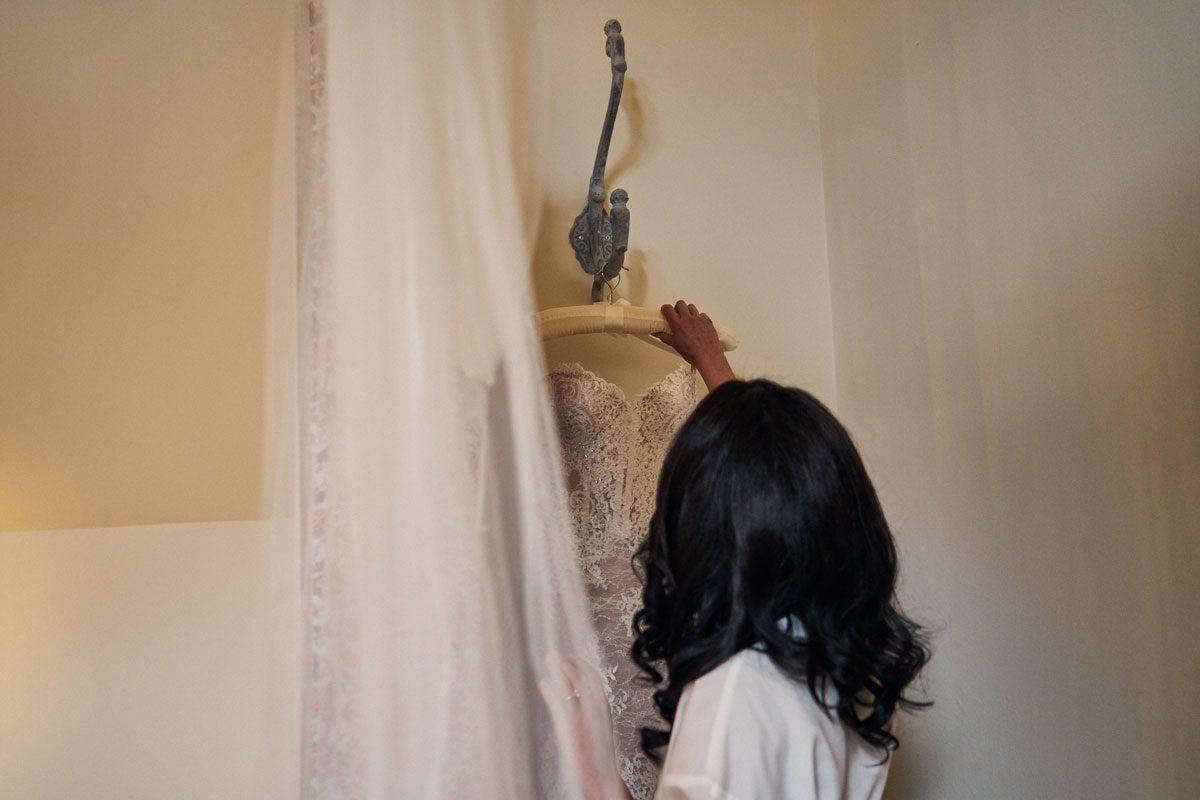 Bride reaching for her Morgan Davies wedding dress
