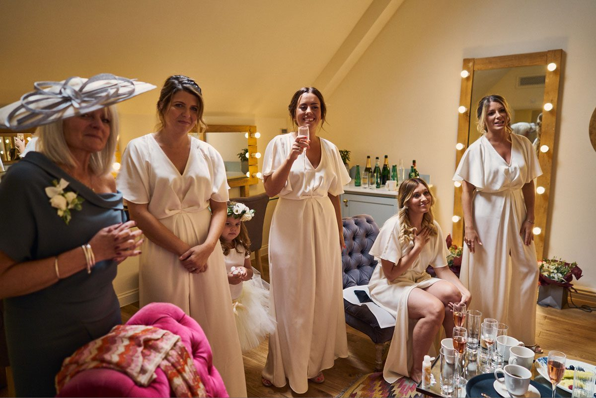 Bridesmaids amazing reaction to seeing the Bride's wedding dress for the first time