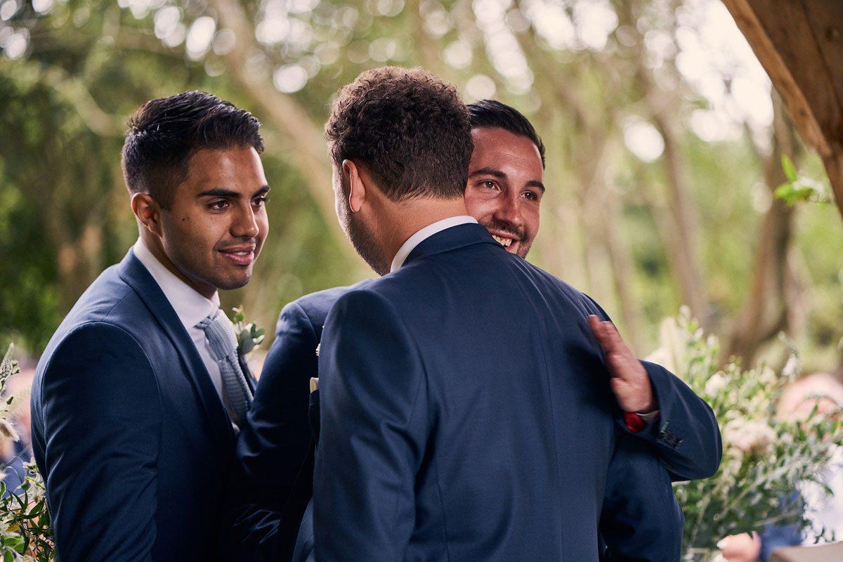 Best Men comforting emotional groom before wedding ceremony