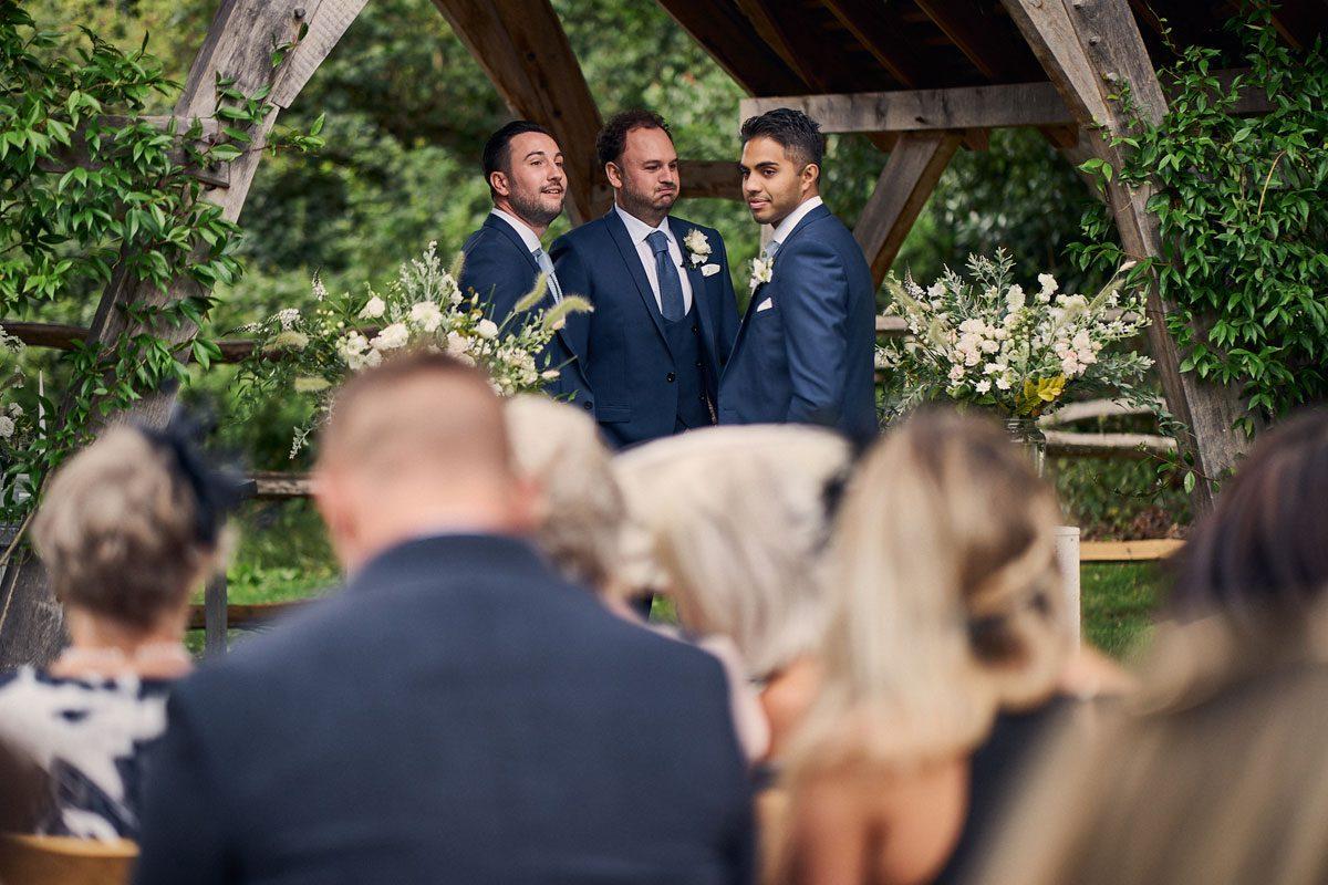 groom waiting for bride at Millbridge Court outdoor wedding ceremony