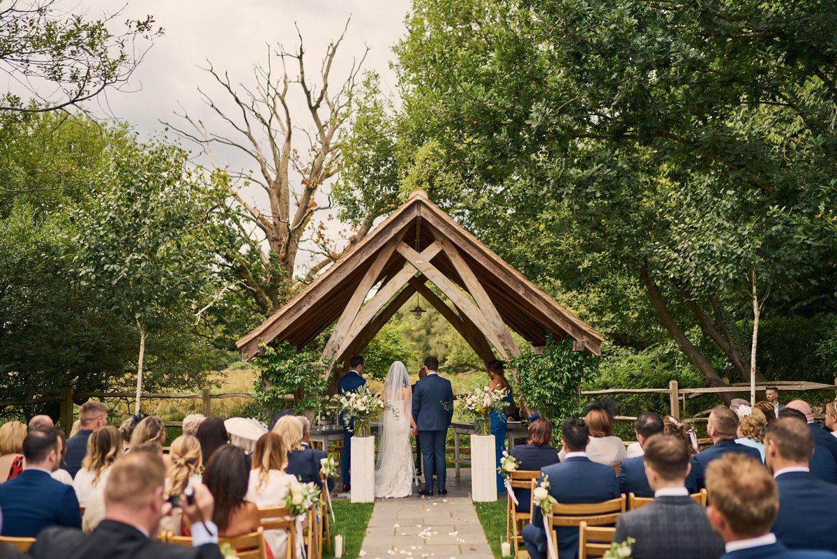 outdoor wedding ceremony at Millbridge Court