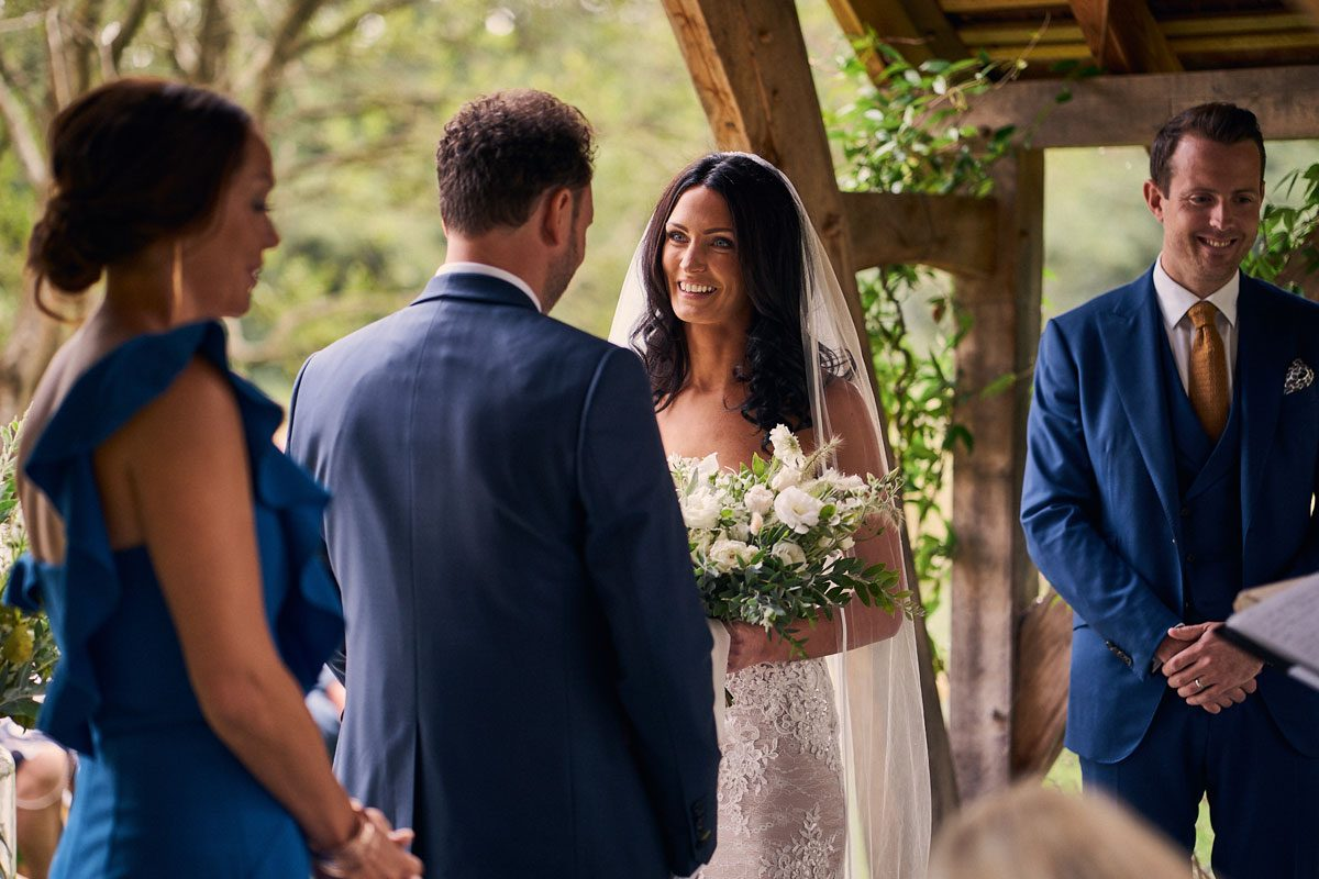 Bride smiling at Groom during outdoor wedding ceremony
