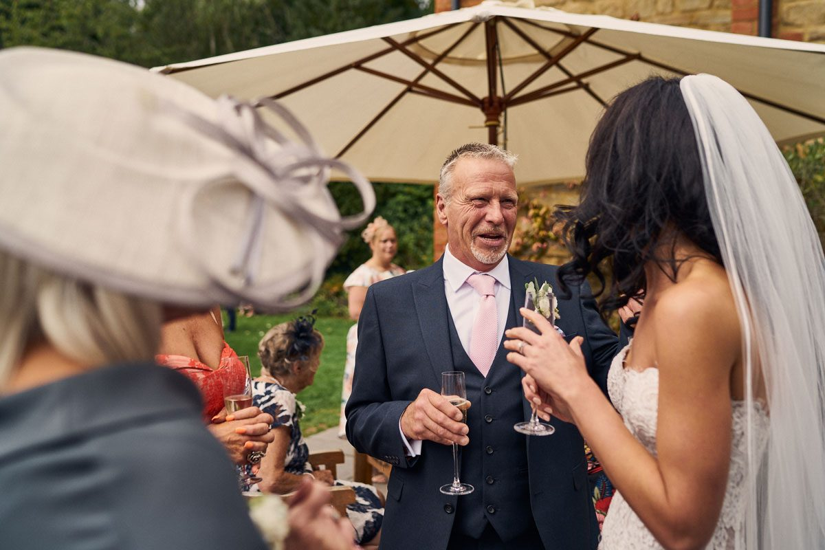 Father of the Bride laughing and smiling with Bride
