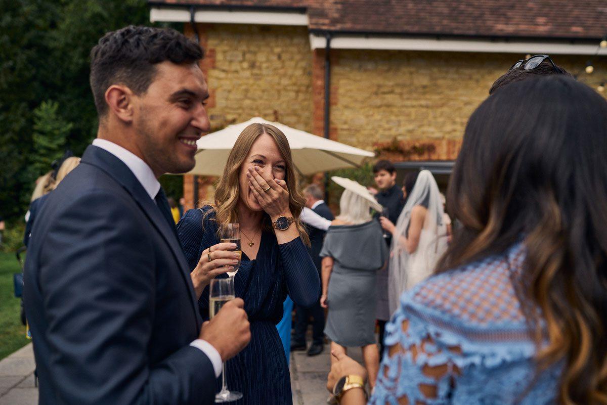 wedding guest looking shocked at a joke