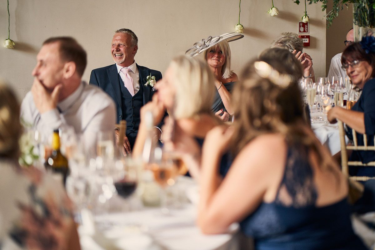 Father of the Bride laughing at the Groom's speech
