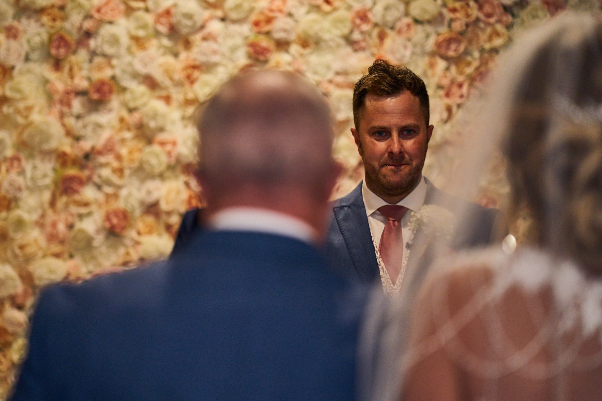 grooms reaction to seeing bride walking down the aisle