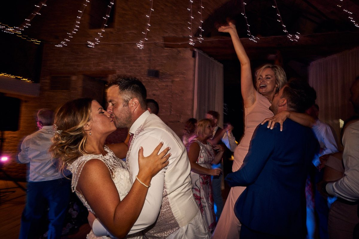 Bride & groom kissing during last dance