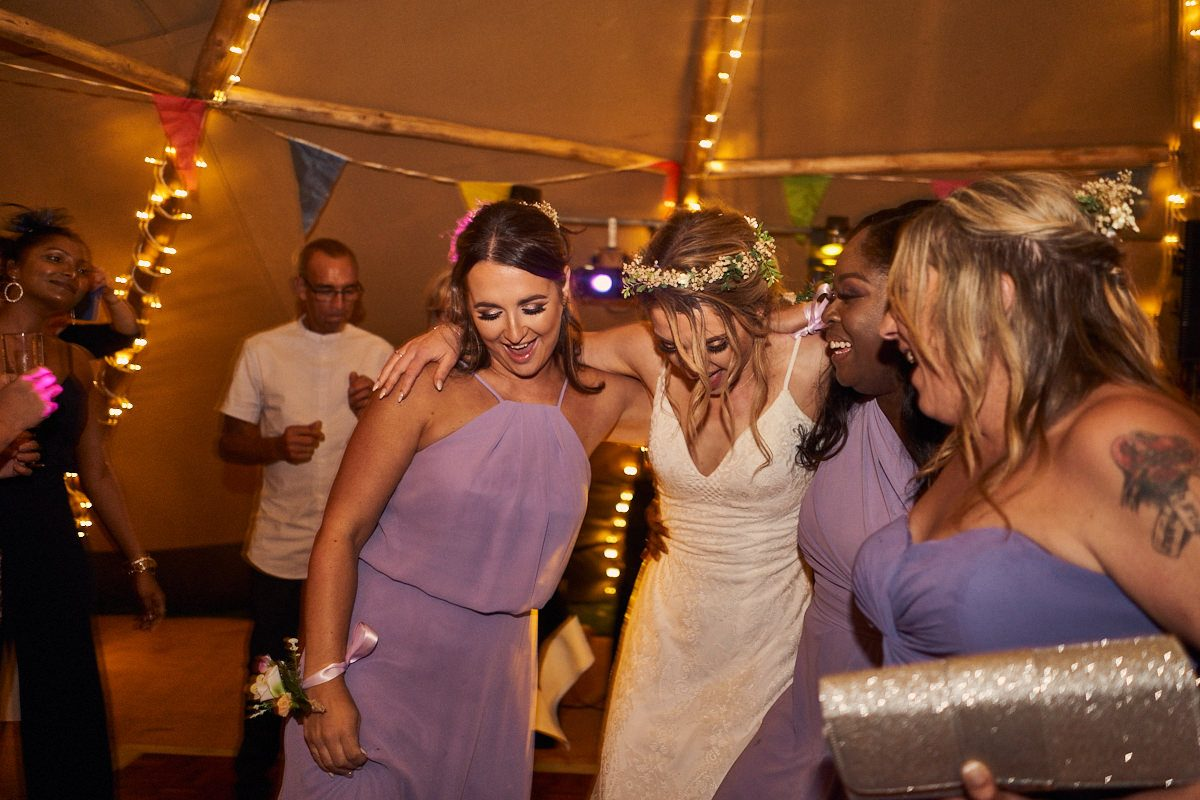 bride dancing with her bridesmaids