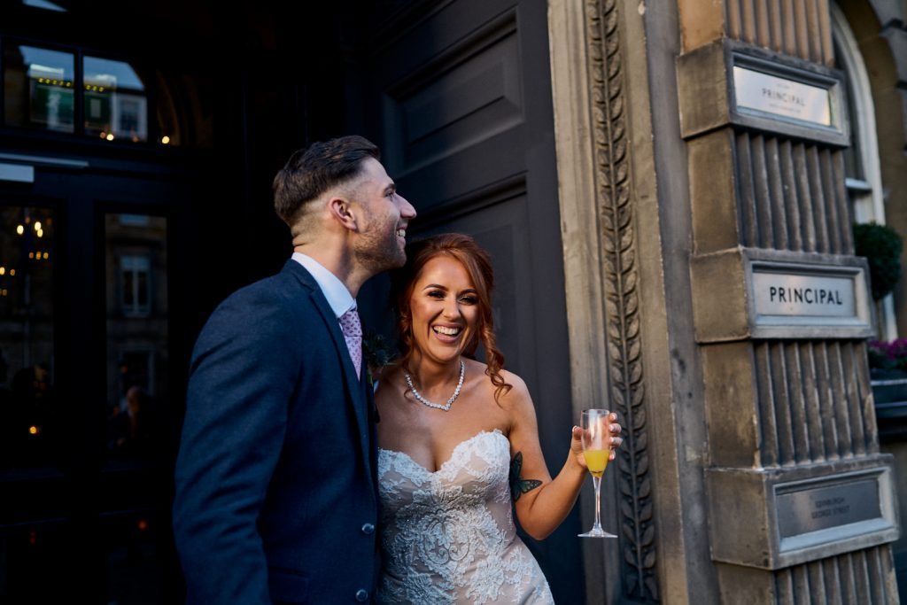 Bride & Groom celebrating outside The Principal Hotel on George Street, Edinburgh
