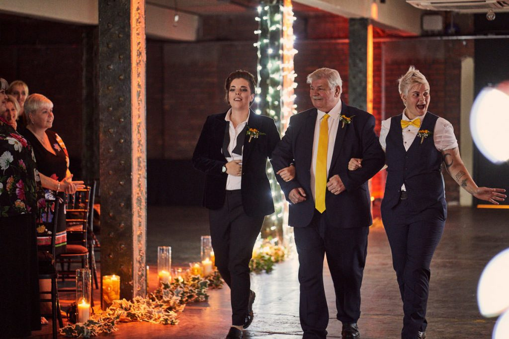 one dad walks two brides down the aisle