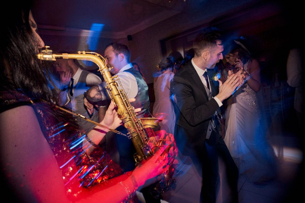 sax playing along with DJ at wedding