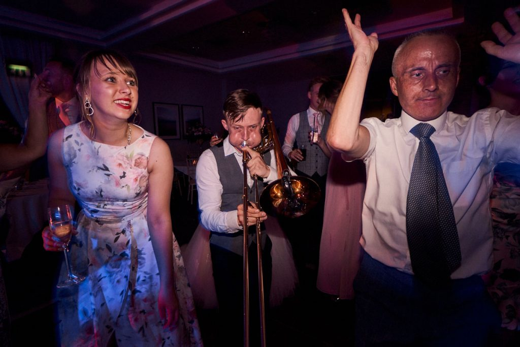 Live trumpet player on dance floor at wedding