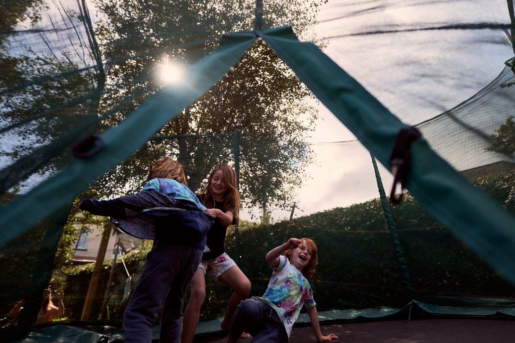 kids bouncing on trampoline
