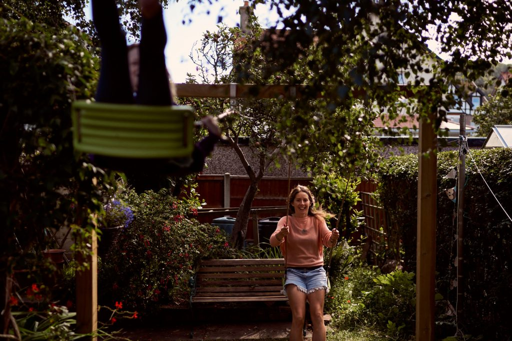 mother and daughter swinging on swings