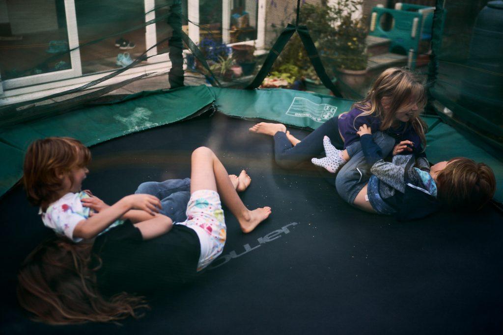 kids wrestling on trampoline