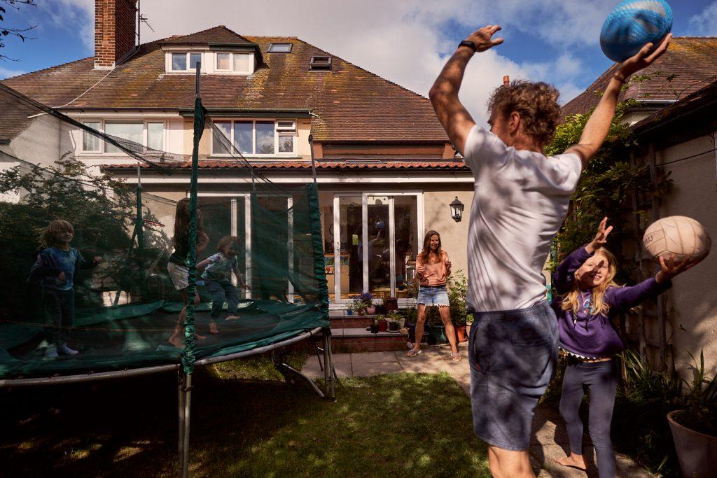 family of 6 having fun in their back garden