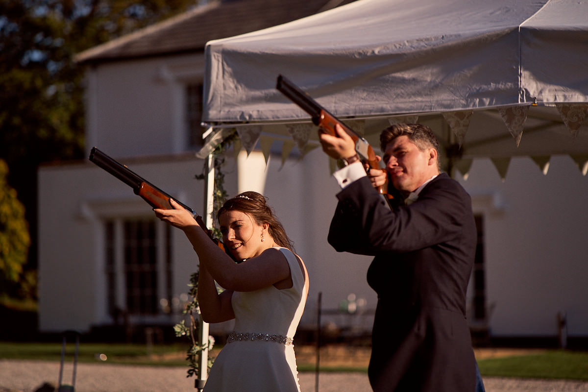 bride and groom clay shooting at their wedding at Pentre Mawr, North wales