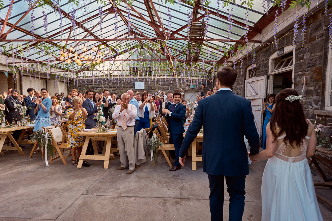 Newly married couple entering Plas Dinam's Party Stables
