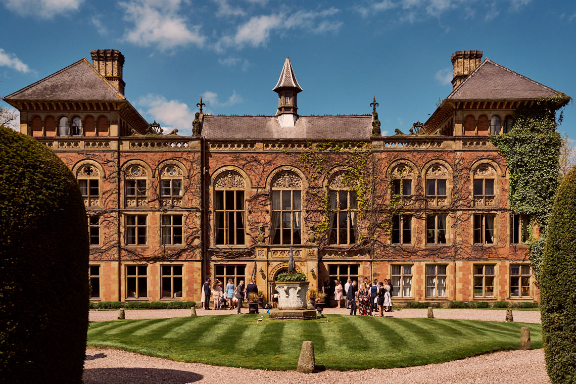 wedding guests gathering outside Soughton Hall, Mold.