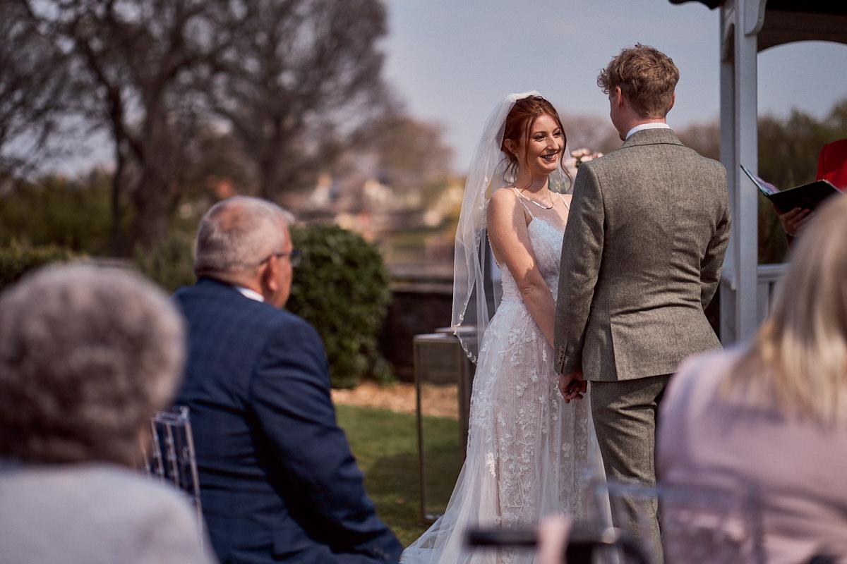 bride looking lovingly at her groom