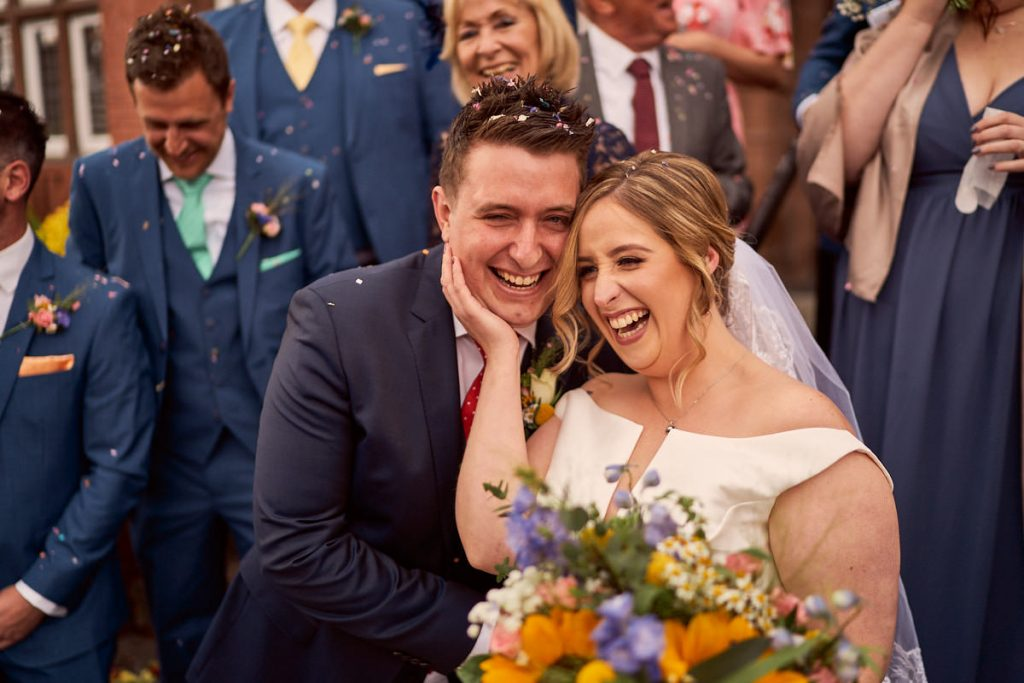 Bride & groom outside Altrincham Town Hall covered in confetti