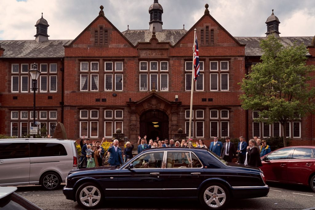 bride and groom leaving Altrincham Town Hall