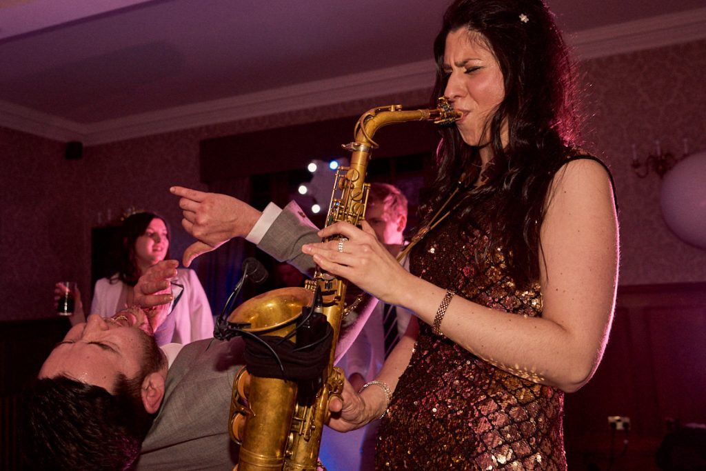 saxophonist playing during a wedding party