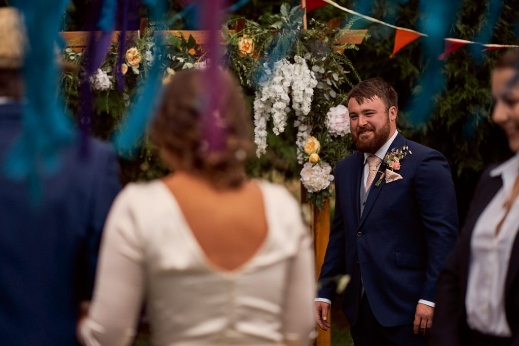Grooms reaction to seeing his bride for the first time.
