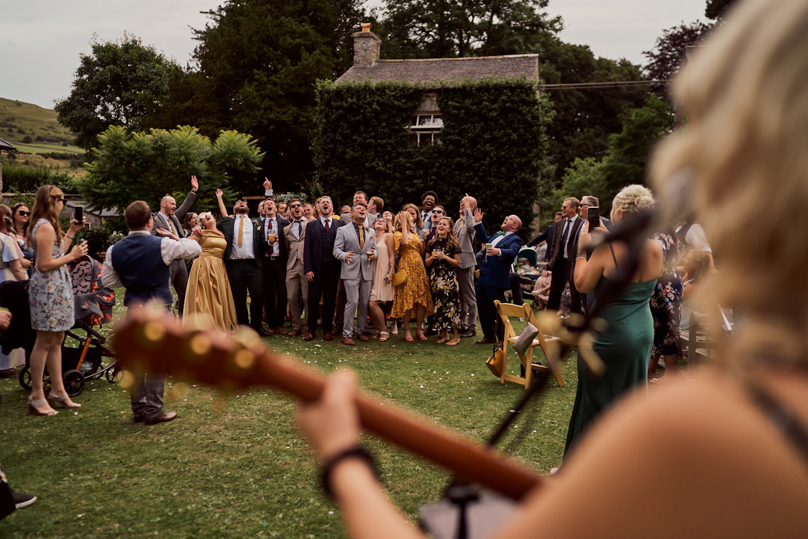 wedding guests at Longlands At Cartmel lsigning along to live music