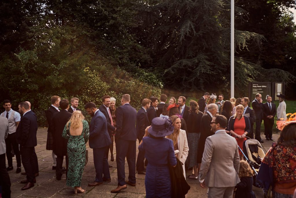 guests gathering outside art gallery wedding venue