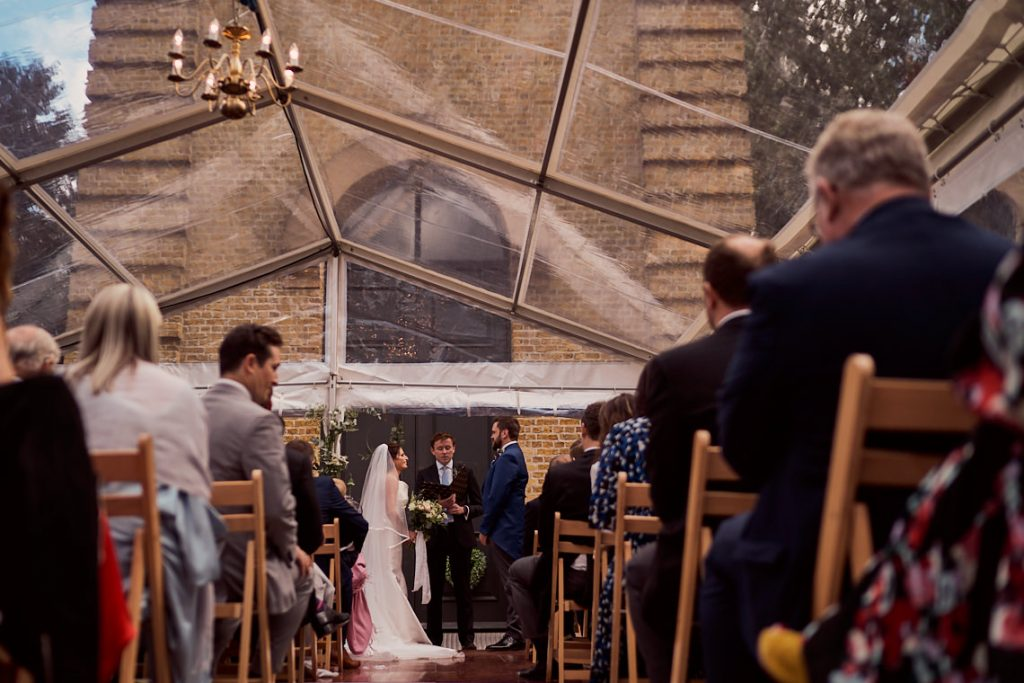 bride and groom outside the pump house gallery in Battersea park