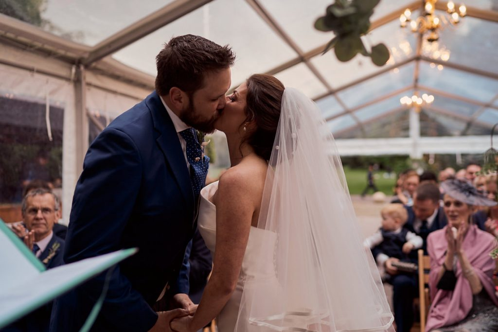 bride and groom's first kiss in Battersea park wedding