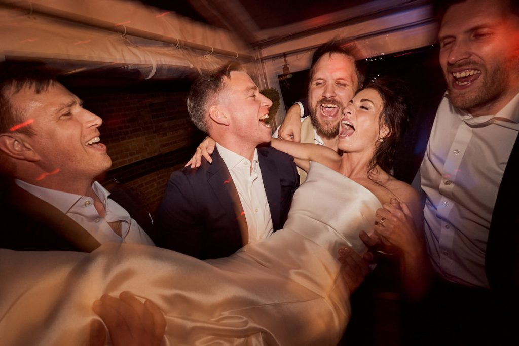 bride being picked up on the danceflorr