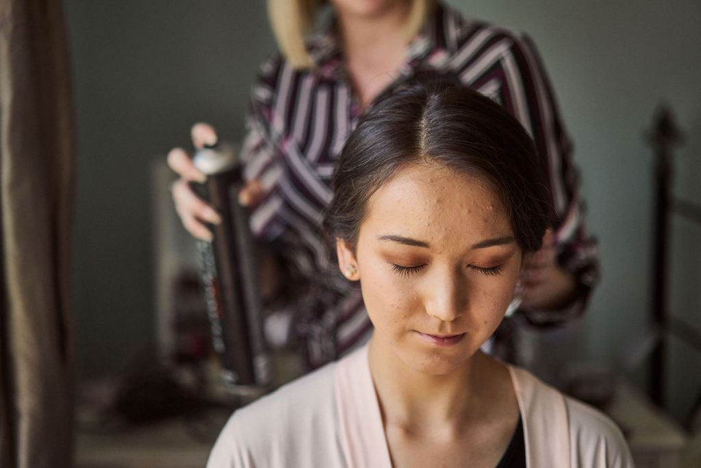 Bridesmaid having her hair done ready for her sister's wedding