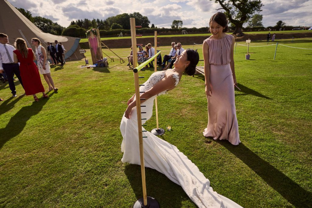 Bride doing the limbo