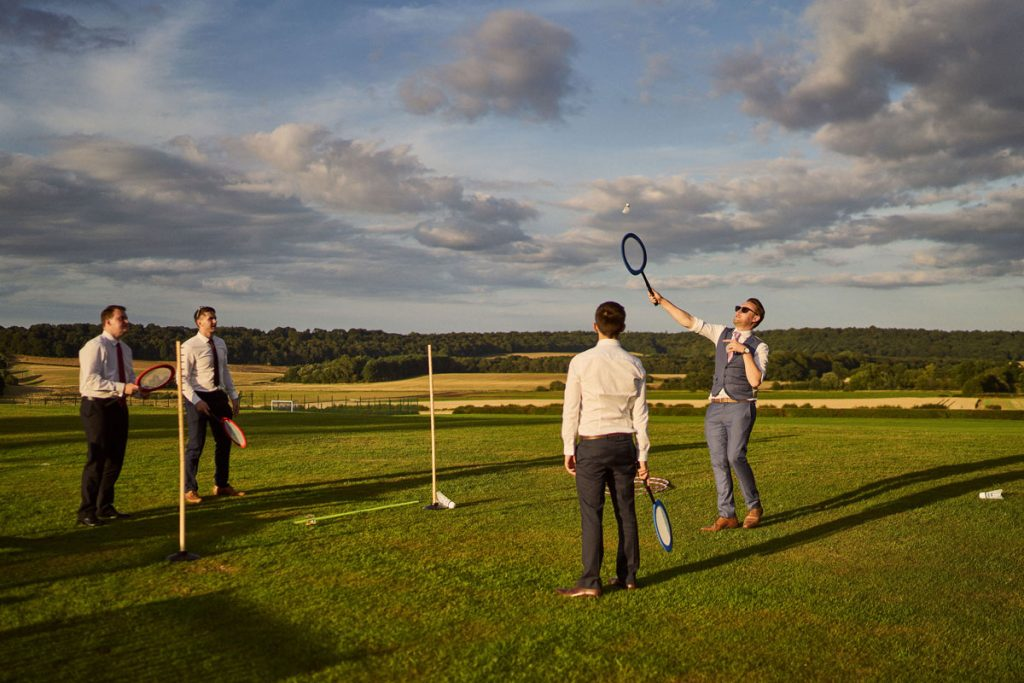 wedding guests playing badminton