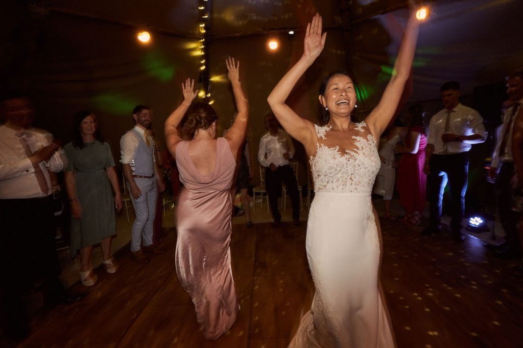 Bride & Bridesmaids having a dance