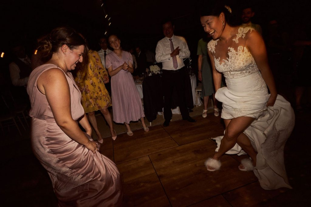 Bride dancing in her slippers