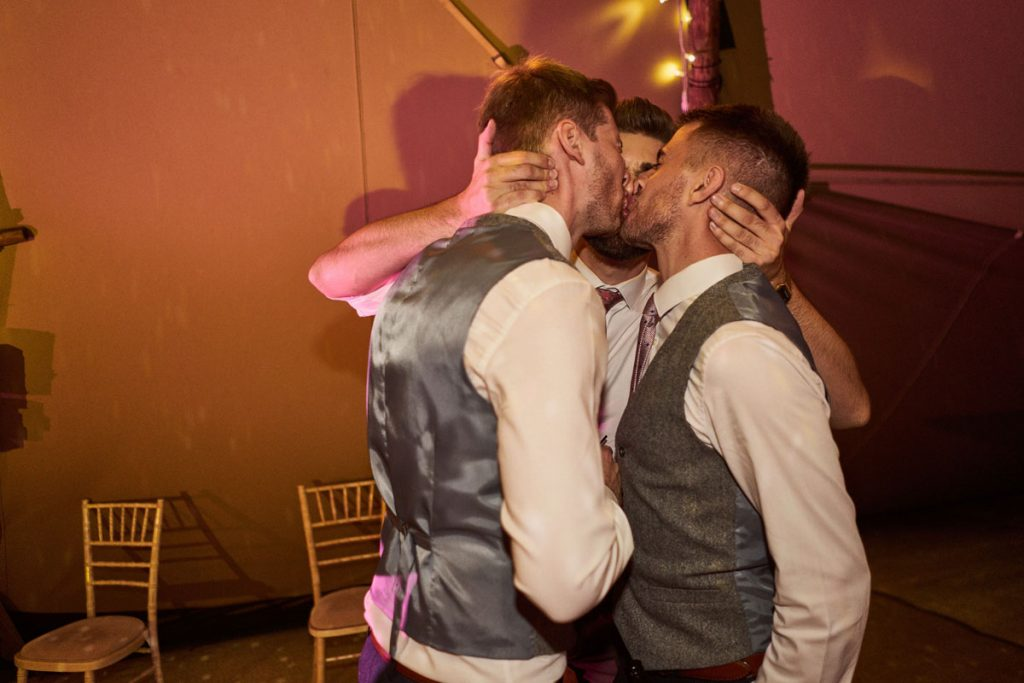 wedding guest kissing