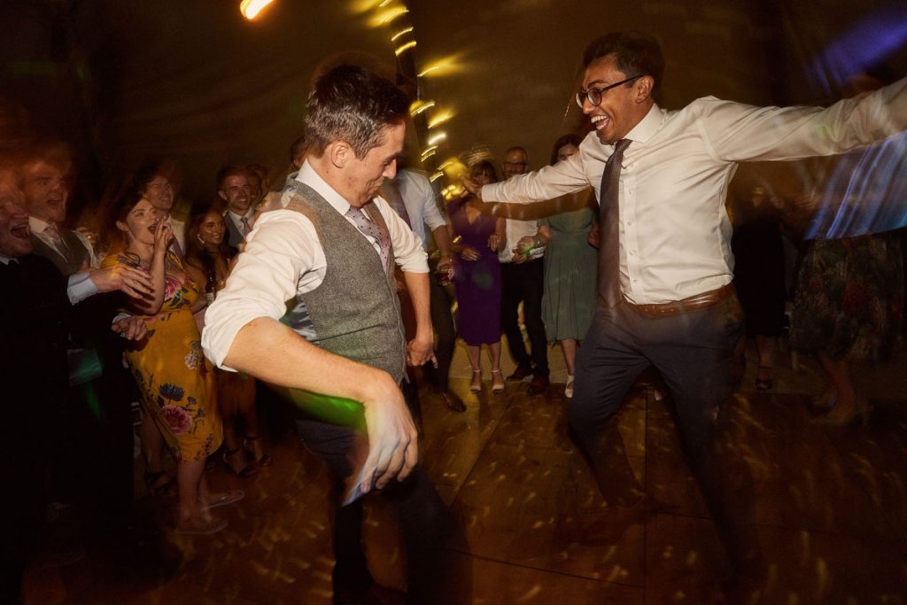 Groom & wedding guest having a dance off