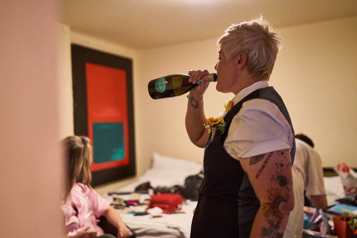Bride drinking Prosecco from the bottle