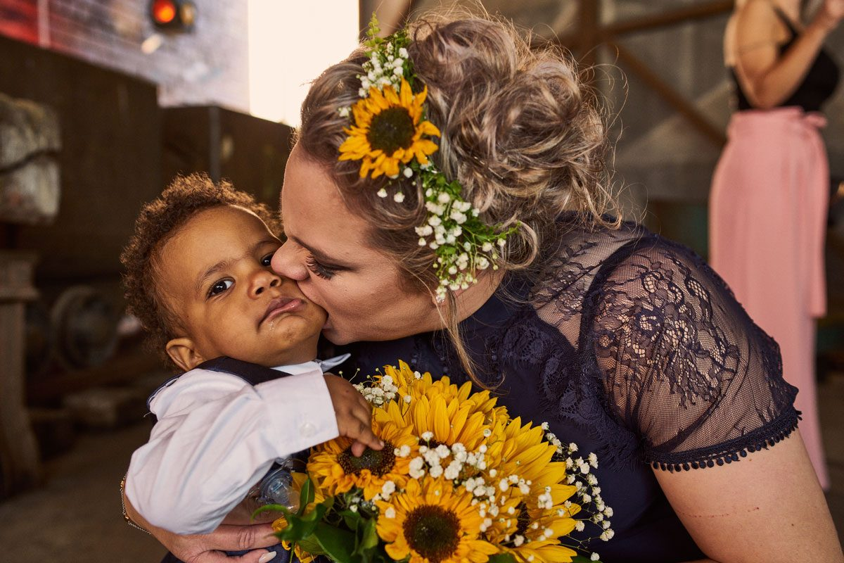 Bridesmaids kissing her son