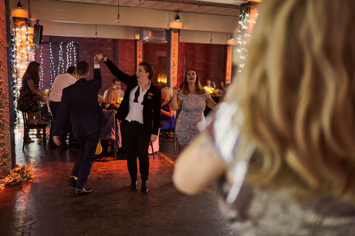 Bride dancing with wedding guest