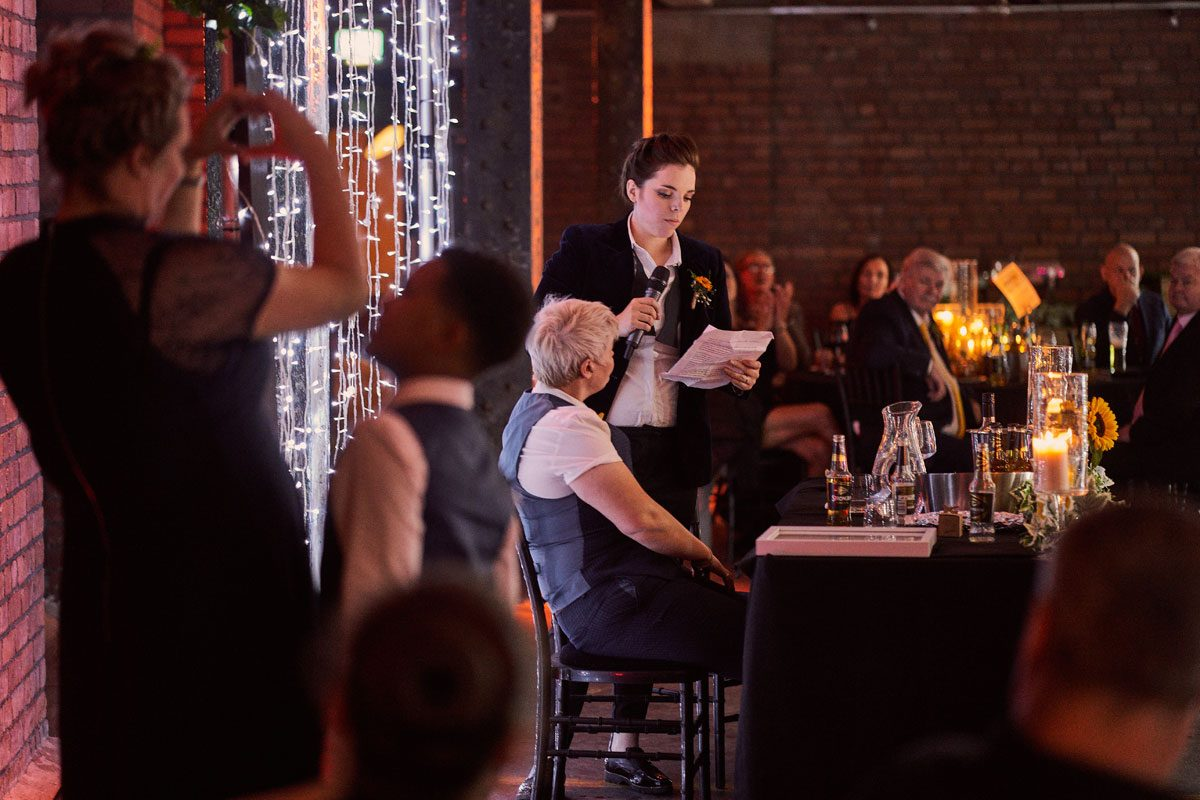 Bride thanking wedding guest during speech