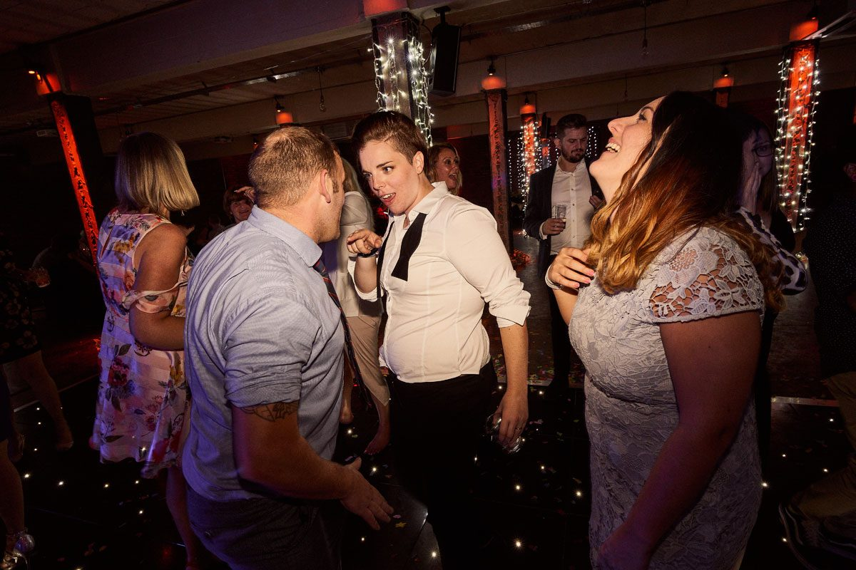 Bride having dance off with wedding guest