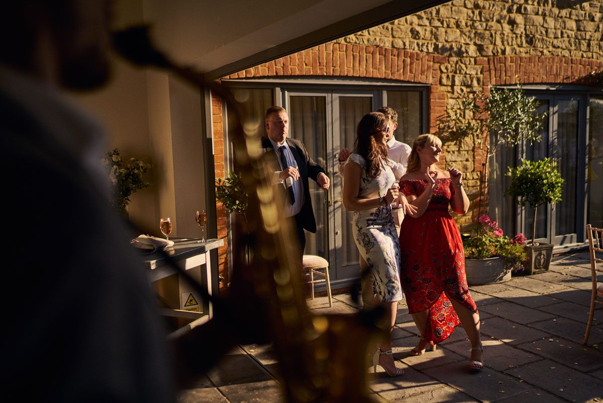 wedding guest dancing as Dan Goode plays sax