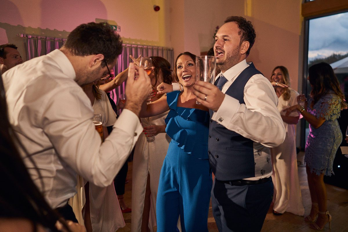 Groom dancing with wedding guests