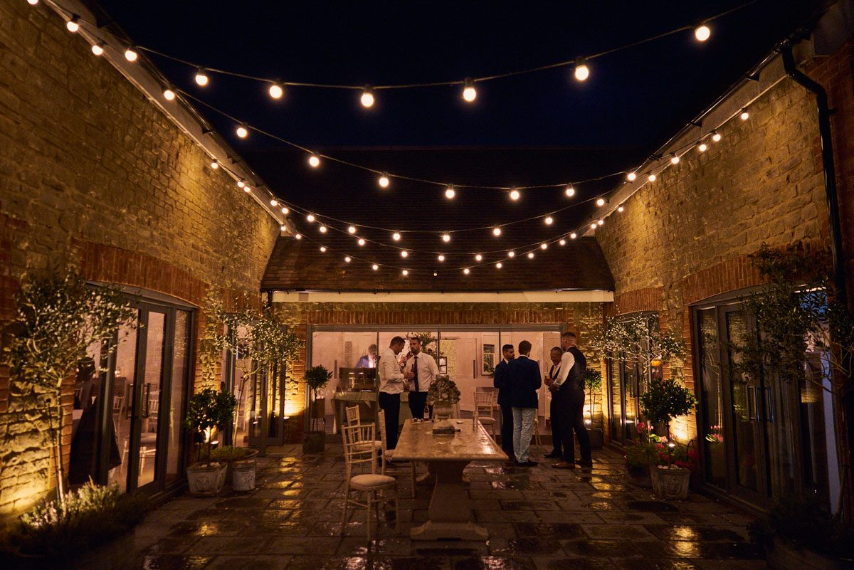 Millbridge Court terrace at night, with festoon lighting