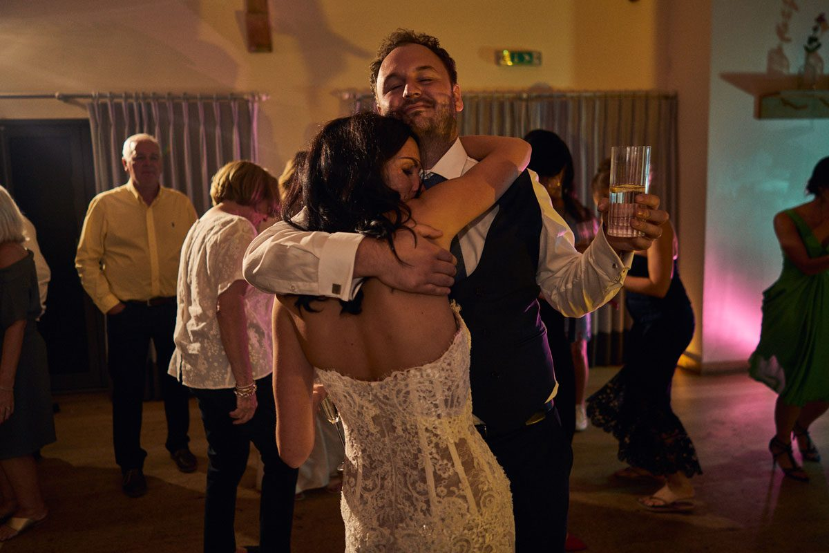 Bride & Groom having a quite moment on a busy dance floor