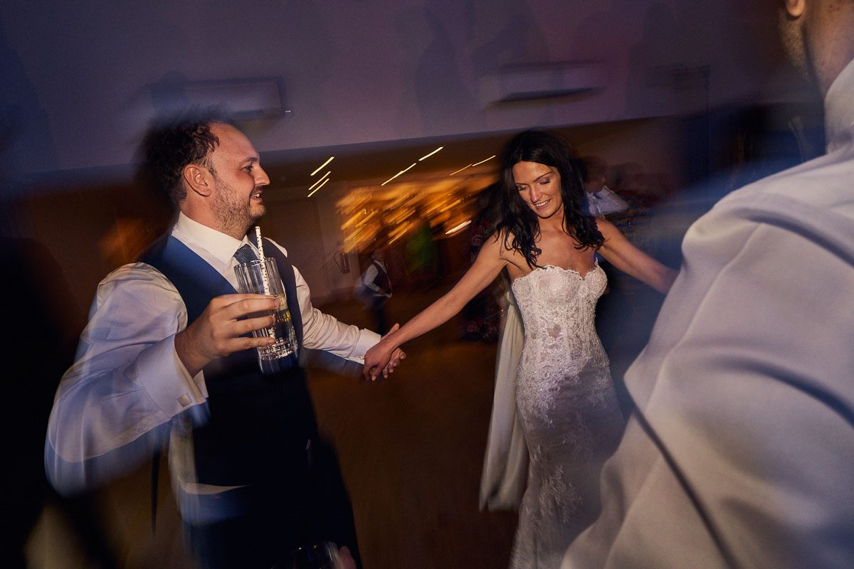 Bride & Groom holding hands while dancing